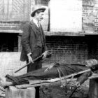This image of Constable J. L. McGowan standing, rifle in hand, over the corpse of ?Railroad Bill? strapped to a wooden plank, sold for 50 cents in the days following the notorious outlaw's death in March 1896.