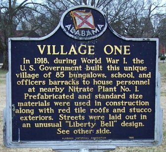 """In 1918, during World War I, the U.S. Government built this unique village of 85 bungalows, school, and officers barracks to house personnel at nearby Nitrate Plant No. 1. Prefabricated and standard size materials were used in cnstruction along with red tile roofs and stucco exteriors. Streets were laid out in an unusual """"Liberty Bell"""" design."""