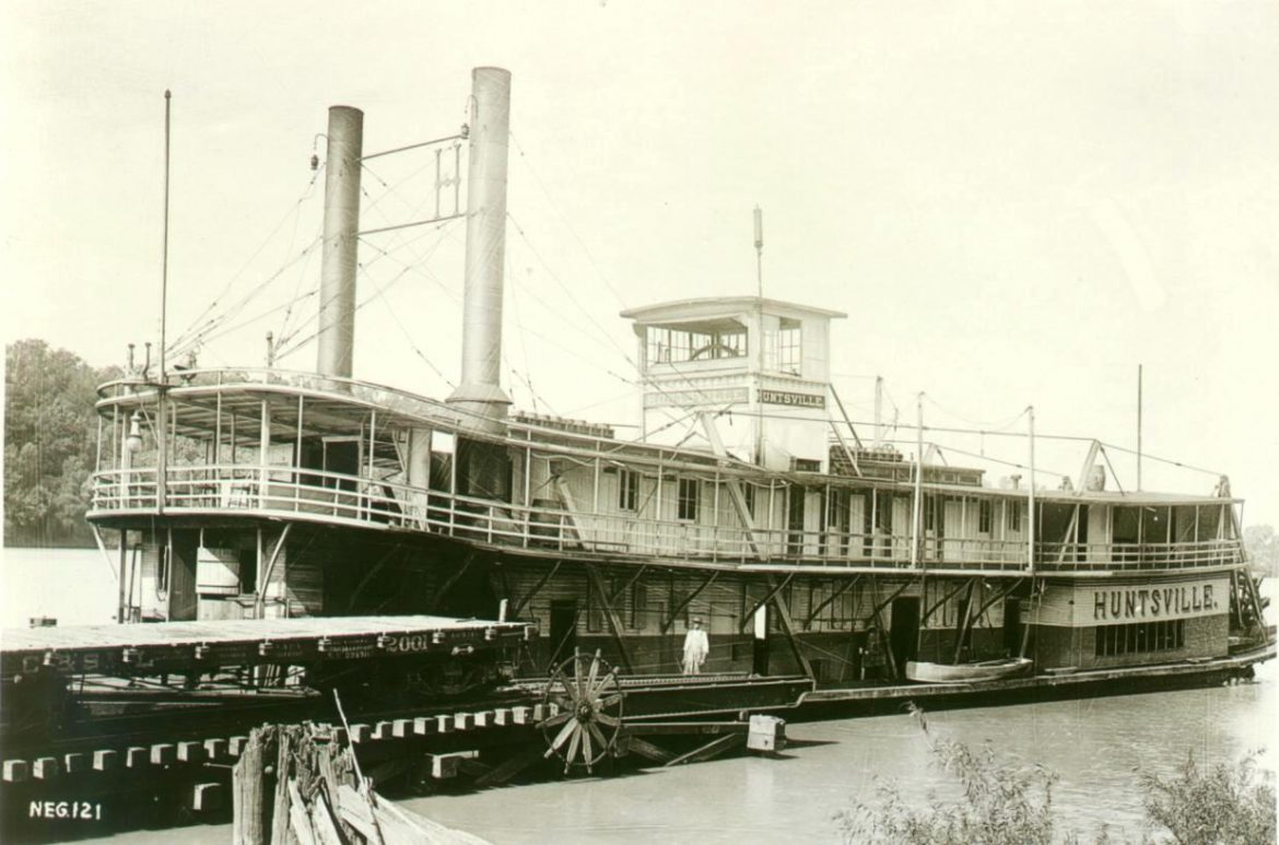 Riverboat Hunstville is maneuvering into position at the end of the rails at Hobbs Island to take on railroad cars for their trip down the Tennessee River to Guntersville Landing, where they will continue their journey over land to Gadsden, Alabama