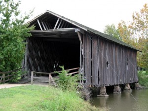A photo of the Alamuchee-Bellamy Covered Bridge in Sumter County, Alabama. It was taken by M.L. Devall in October 2007 on the campus of the University of West Alabama.