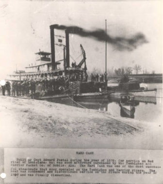 """Steamboat """"Hard Cash."""" The boat was built in 1876 and was condemned in 1909. It operated on the Tombigbee and Warrior Rivers in Alabama."""