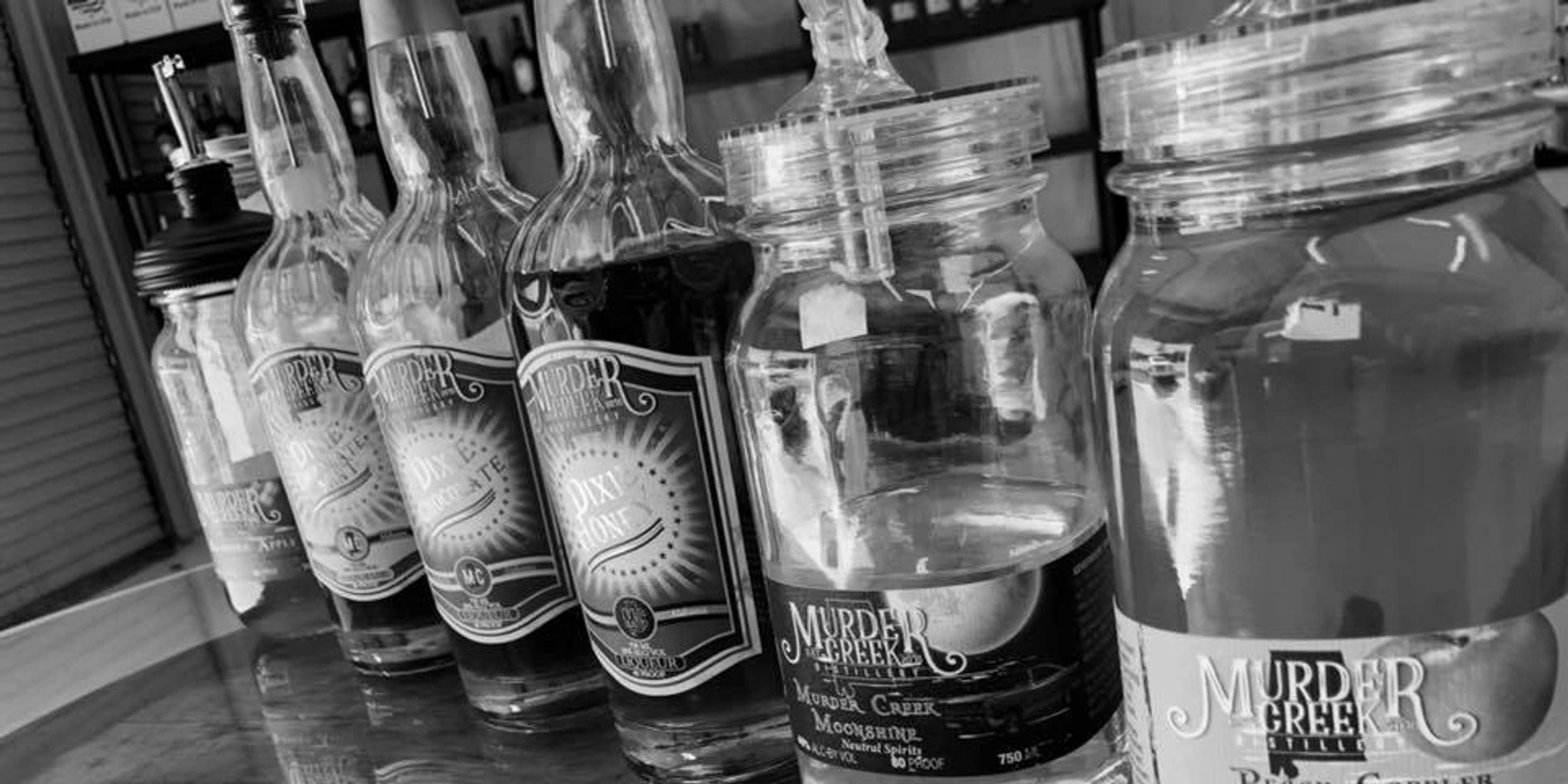 Our Moonshine is crisp and smooth. Our alcohol is distilled to the highest purity in small batches. We use a double distillation process, with each batch being filtered multiple times through charcoal and a unique pour bed to remove impurities. This pure alcohol is bottled at 80 proof as our Murder Creek Moonshine, or cut down to 40 proof and mixed with our special flavors in each batch.